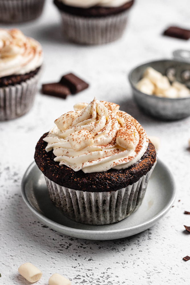 Vegan Hot Chocolate Cupcake On A Small Plate Dested With Cocoa Powder