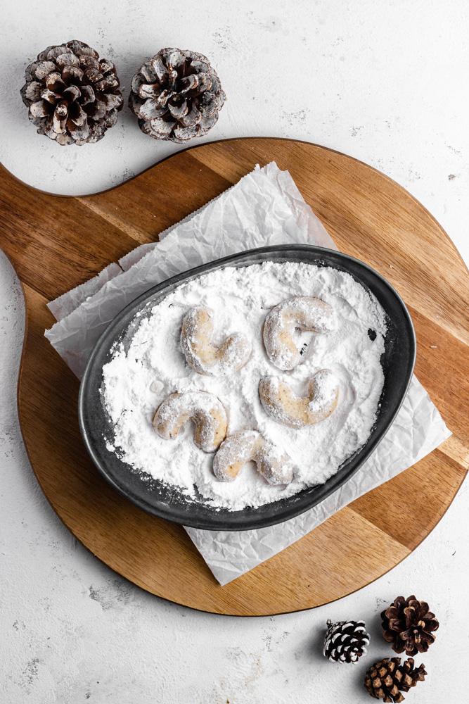 Coat still warm cookies in powdered sugar