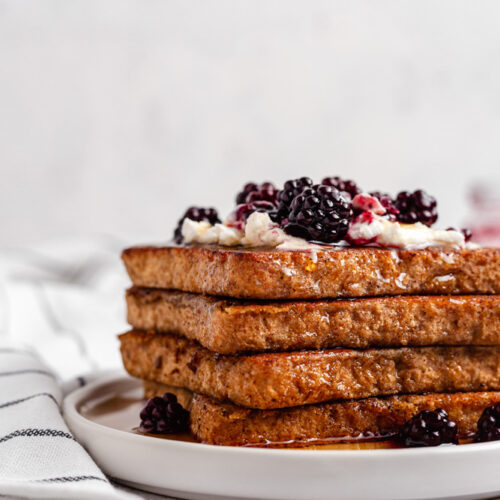 Close Up Of French Toast Topped With Blackberries