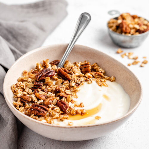 A Bowl Of Yogurt With Granola On Top