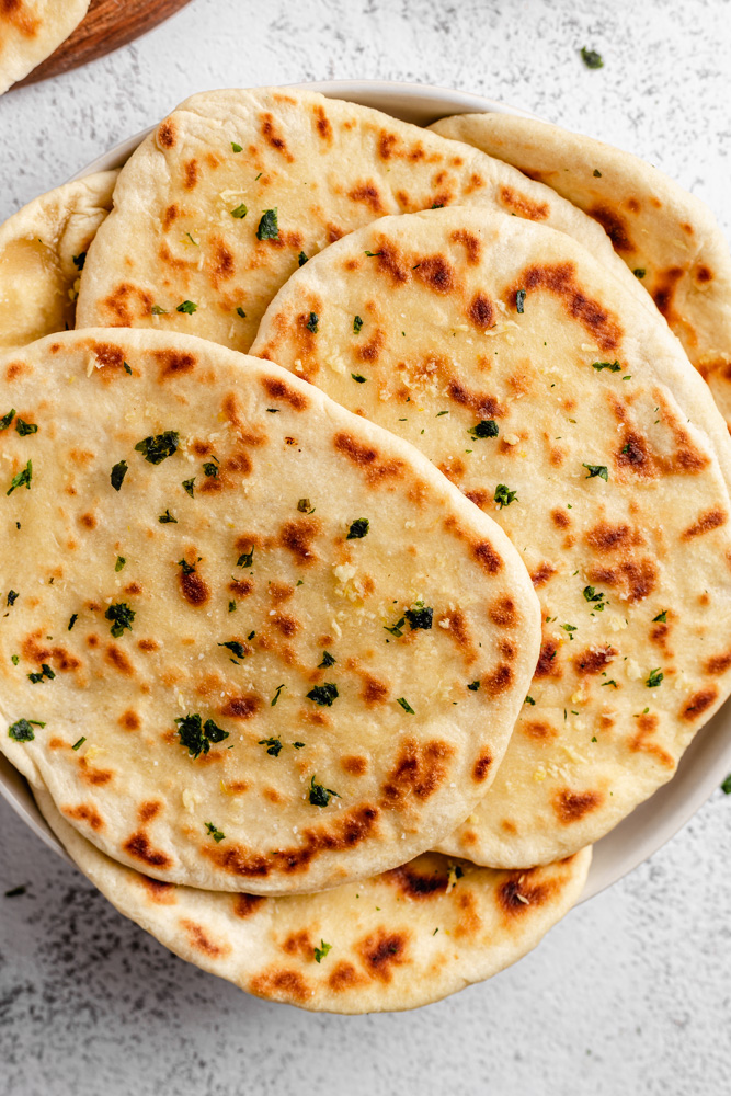 Closeup Of Naan Bread Served With Garlic Butter And Parsley