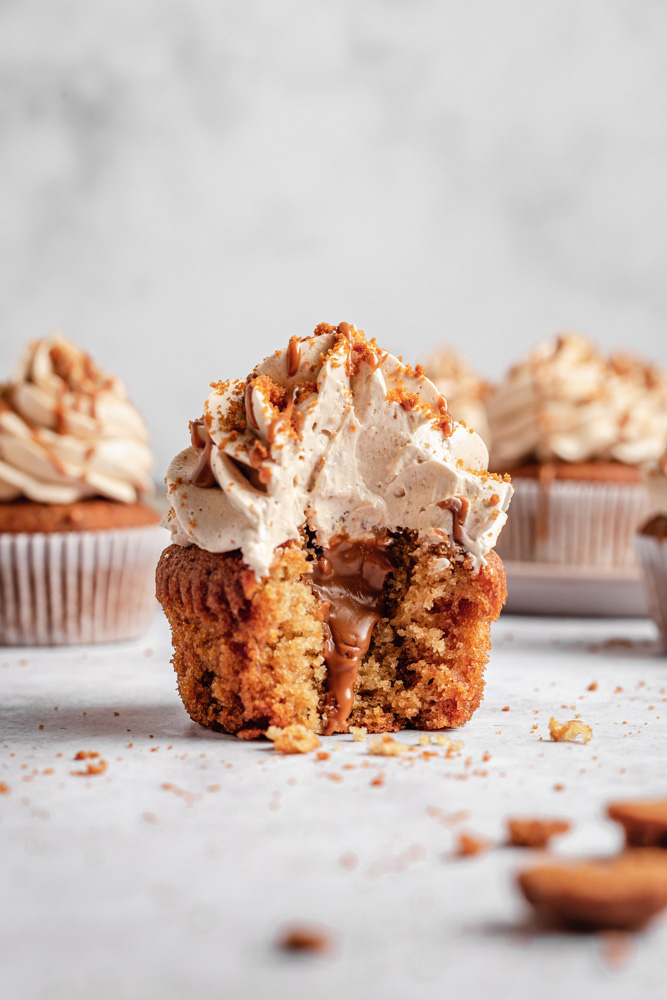 Vegan cupcake filled with Biscoff spread and topped with buttercream frosting