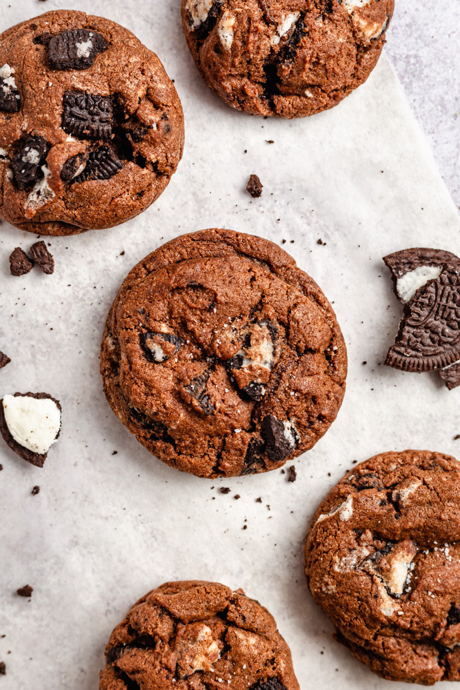 Cookies with chunks of Oreos on parchment paper