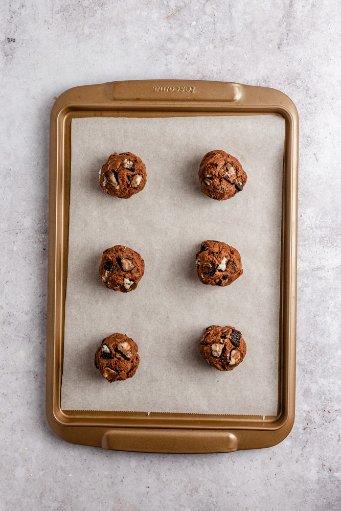 cookie dough balls on a baking tray