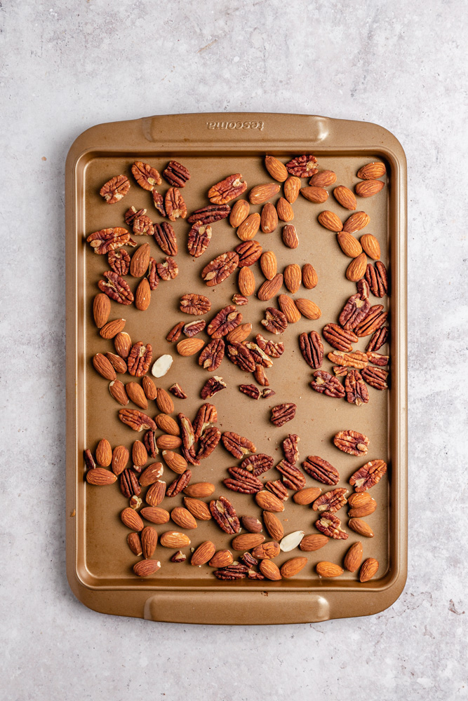 Almonds and pecans on a baking tray