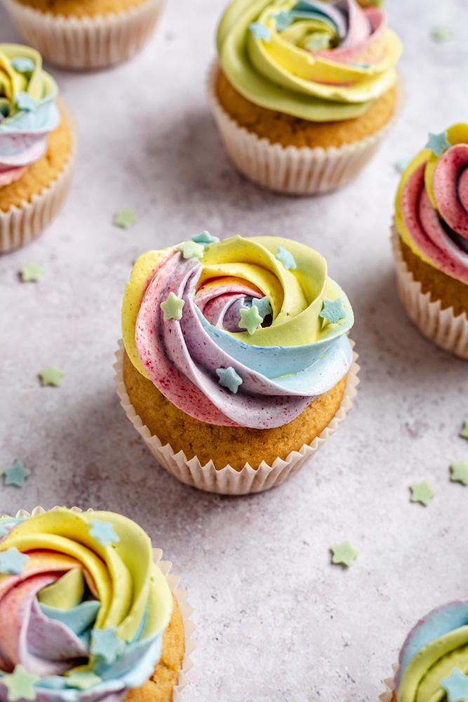Vanilla cupcakes with vegan rainbow frosting