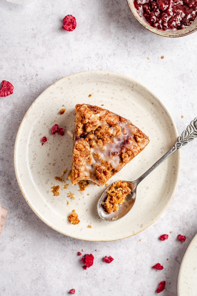Raspberry cake with streusel topping on a plate