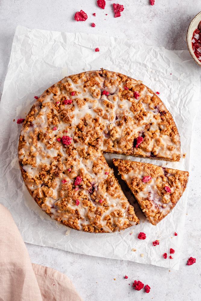 Raspberry coffee cake drizzled with glaze